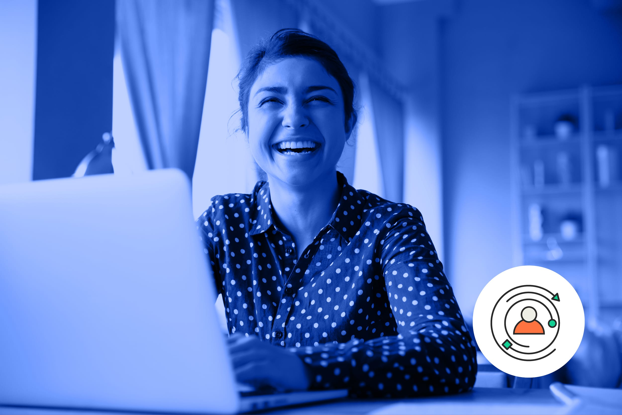 A female candidate smiles as she sits in front of her laptop.